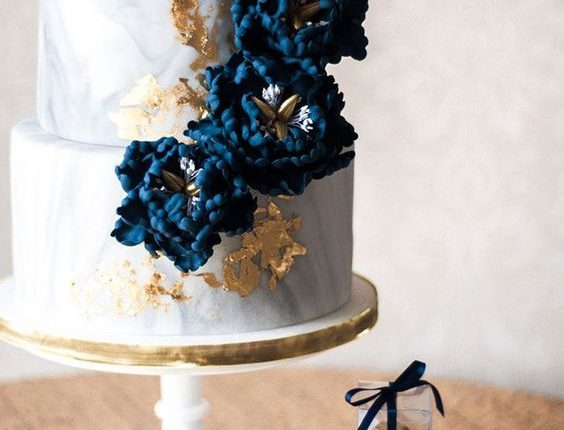Marbled wedding cake with navy blue sugar peonies and 24k gold leaf