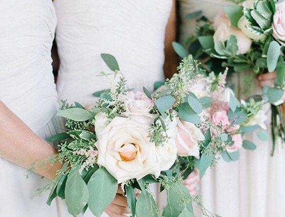Rose, ranunculus, hydrangea, and eucalyptus wedding bouquets