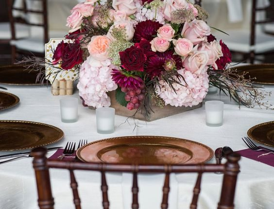 blush, merlot and marsala centerpieces with gold accents for a fall wedding