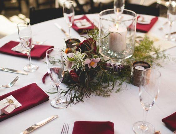 burgundy and greenery wedding centerpiece