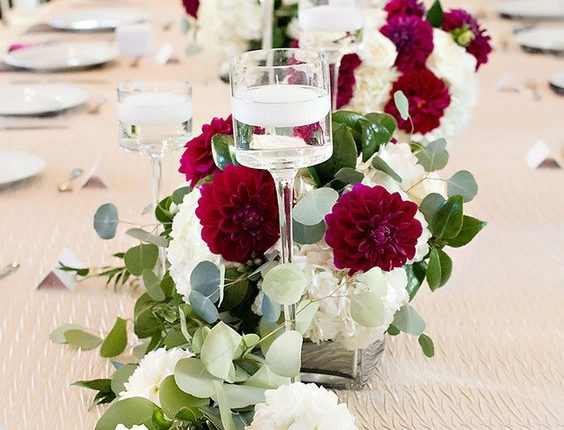 burgundy greenery and floating candles wedding centerpiece