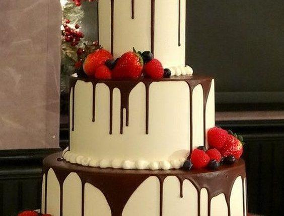 chocolate dripped wedding cake with fresh fruit