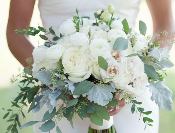 roses, ranunculus, liasianthus, dusty miller, snowberry, eucalyptus wedding bouquet
