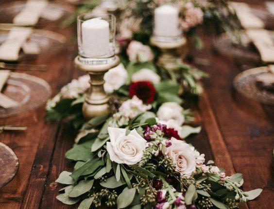 willow eucalyptus filled with vendela roses burgundy wedding centerpiece