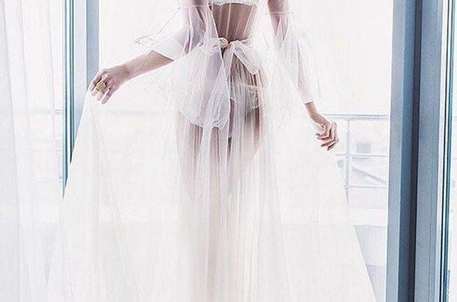 wedding boudoir book sexy photo with veil in front the window marat akhmetzyanov photo